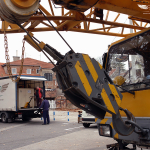 Heavy equipment moving via crane