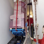 Robotic moving of heavy medical equipment