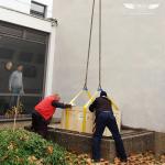 Heavy equipment moving via crane